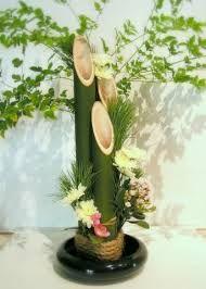 Resultado de imagen para centros de mesa con bambu para boda