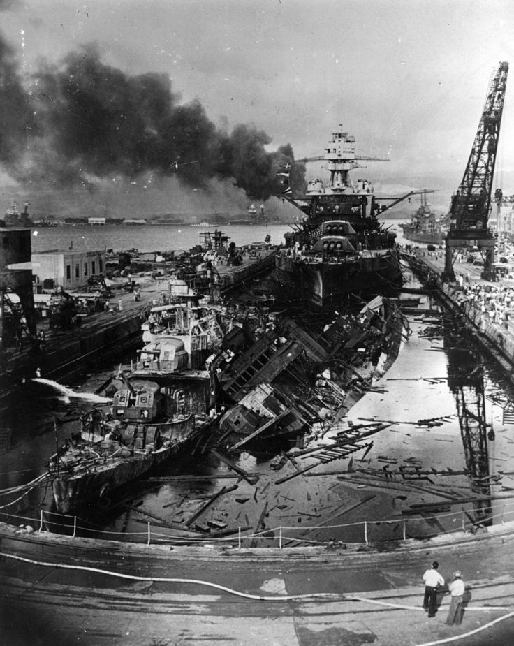 Pearl Harbor. The jumbled mass of wreckage in front of the battleship USS Pennsylvania constitutes the remains of the destroyers USS Downes and USS Cassin, bombed by the Japanese during the raid on Pearl Harbour. The ships were in drydock. The torpedo-damaged cruiser USS Helena is in the right distance, beyond the crane. Visible in the centre distance is the capsized USS Oklahoma with USS Maryland alongside.