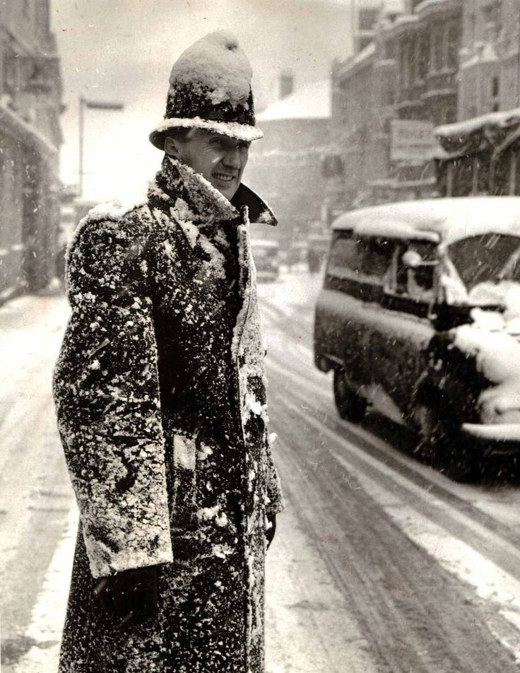 A snow-covered policeman on duty in Liverpool city centre, January 1964.