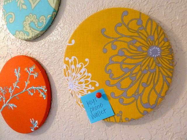 Cork board covered with fabric = pin board!...Ikea sells sets of 3 trivet corkboards (circular) for $2.99!  Office?