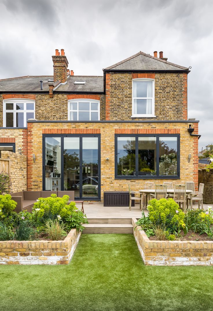 Single storey home flat roof future vertical expansion 6 social side - Flat Roof Rear Extension Putney London Uk Victorian Property London Stock