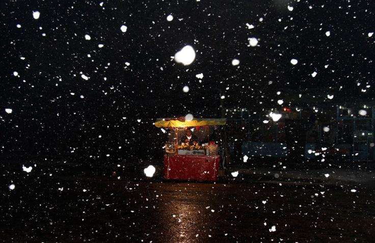 Abdul Ghafar, 38, an Afghan fruit seller, waits for customers on a snowy night in Kabul, on January 6, 2012.: Winter Snow, Snowy Night, Afghanistan Street, Pain Photo, Afghans Fruit