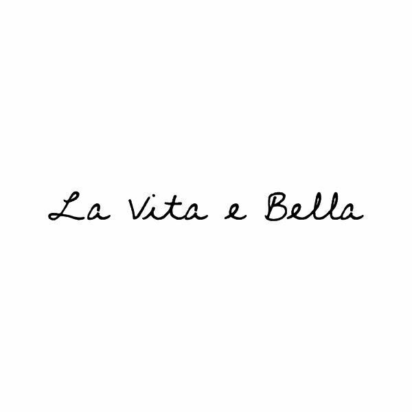 """La Vita é Bella"" means ""LIFE IS BEAUTIFUL""  and  ""La bella vita"" means ""THE BEAUTIFUL LIFE"""