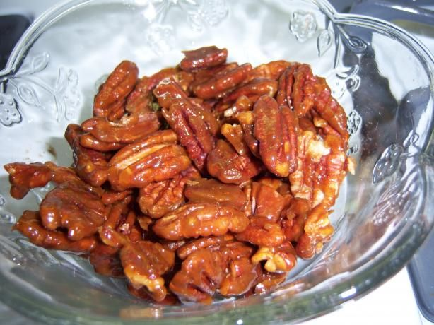 GLAZED PECANS: 2 tablespoons brown sugar, firmly packed 2 teaspoons butter 2 teaspoons light corn syrup 1/8 teaspoon salt 1 cup pecan halves