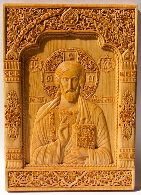 "Woodcarved icon with inlaying ""The Lord Almighty"" 17.7×24.8×1.5 cm; linden wood, natural linen oil varnish, inlaying with amber, 2005 artists are Elena and Sergio Nikolenko"