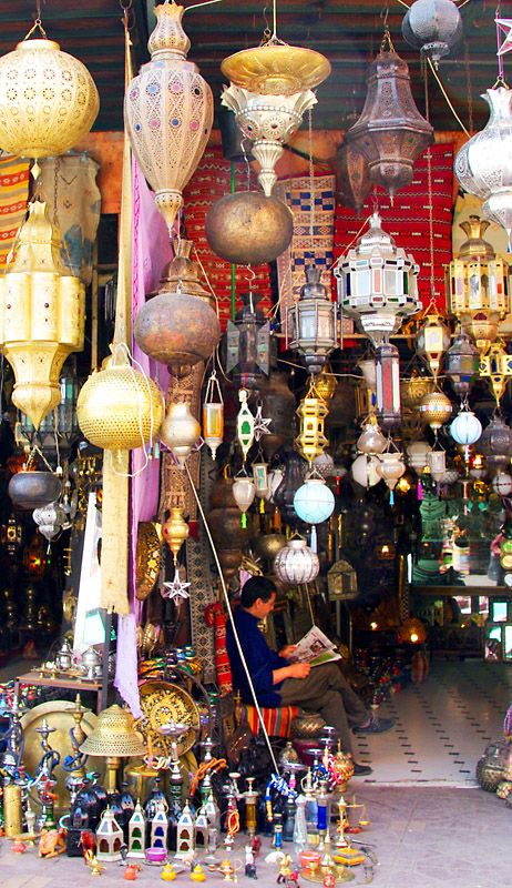 Souk of Marrakech. Side by side lamp shops in this picture, but other items such as scarves, rugs and shoes are also sold.