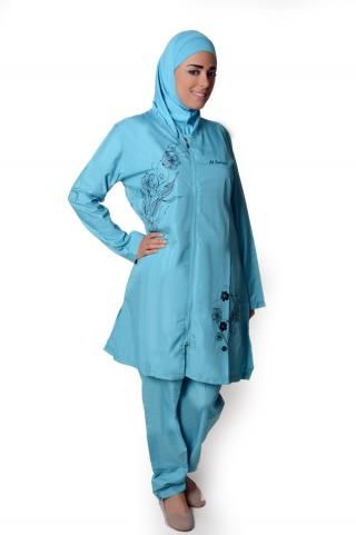 Blue 3-Piece Islamic Swimsuit  This beautiful swimming suit is specifically designed for Muslim women. Made from waterproof swimming suit fabric, it comes adorned with feminine floral designs.   Description: This swimsuit is 3-pieces: the tunic, a two-piece hijab, and the pants. The tunic has a zipper opening for easy dressing.   Material: Waterproof   Origin: Designed and Made in Turkey