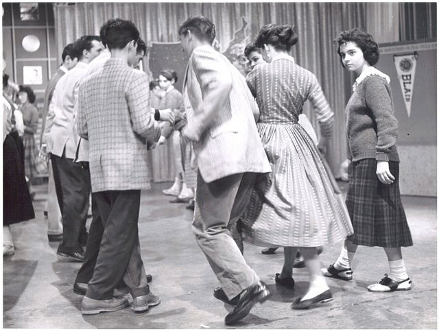 Help with a catchy title for my essay about 1950's dances?.?