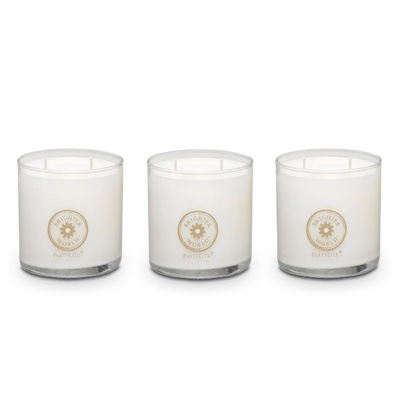 "BRIGHTER WORLD™ BY PARTYLITE SCENTED CANDLE TRIO  Enjoy all three of our treasured worldly scents – Vanilla Tonka Bean, Red Ginger Teakwood and Ylang Ylang Black Currant. Soy blend wax is poured into decaled glass jars. Arrives in specialty gift packaging. 2¾""h. Burn time: 20-30 hours each. $30.00/set of 3 www.partylite.biz/wicksandthings"