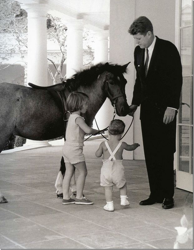 President Kennedy and his children with their pony, Macaroni, at The White House
