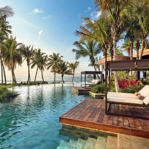 These glorious hotels—from the coasts of the United States, Mexico, and Europe to the islands of the Caribbean and Polynesia—transport us like none other.By Tracey Minkin