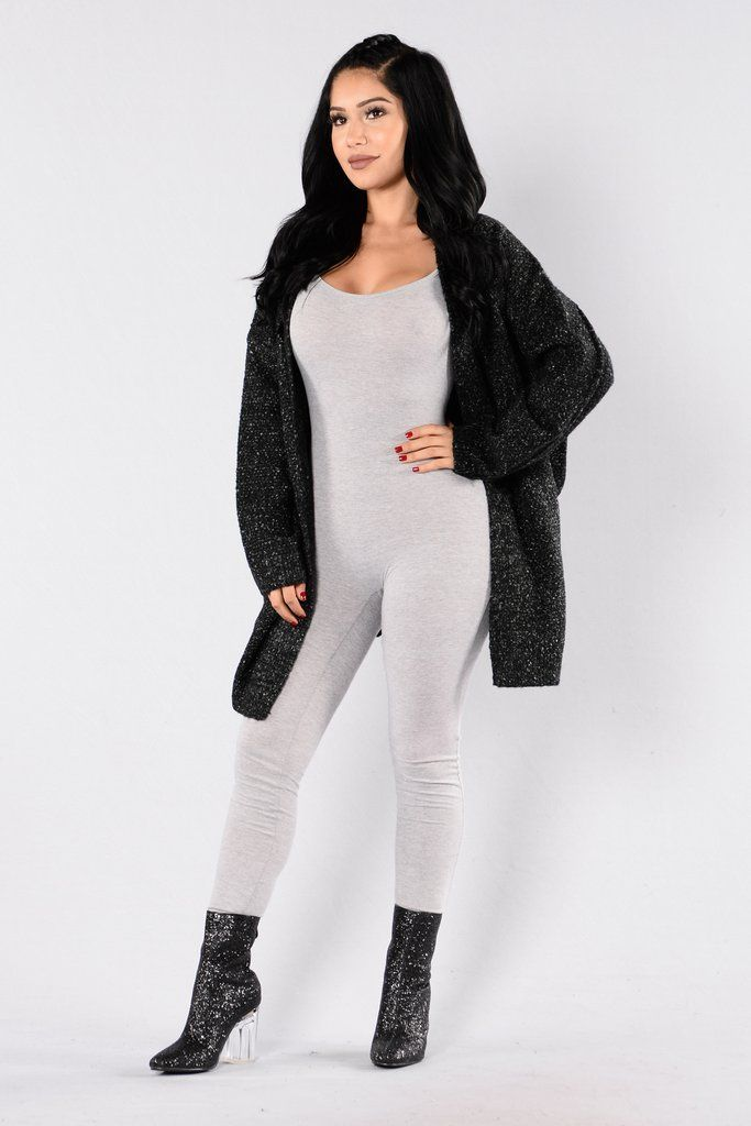 - Available in Black - Over sized Knit Cardigan - Open Front - Long Sleeve - 70% Acrylic 30% Polyester