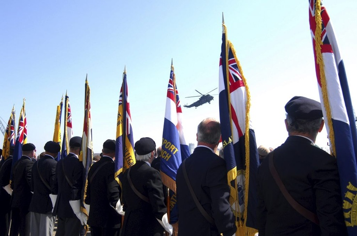 A Sea King does a fly past during the ceremony.
