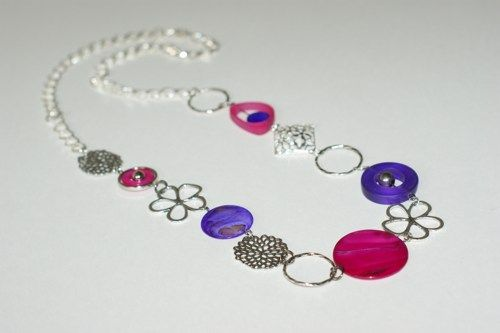 Long modern necklace  made with purple and fuchsia Indonesia resin beads, shell beads, antique metal silver pieces, metal chain.    It's modern and funcky.  Perfect for any seasons.