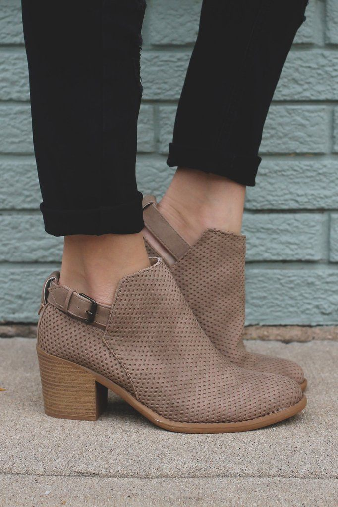 The stunning finishing touch to any Fall outfit is here! Our Spellbound Booties are a pair of distressed, faux suede, almond toe ankle booties with perforated yet solid design, ankle cutout with buckl