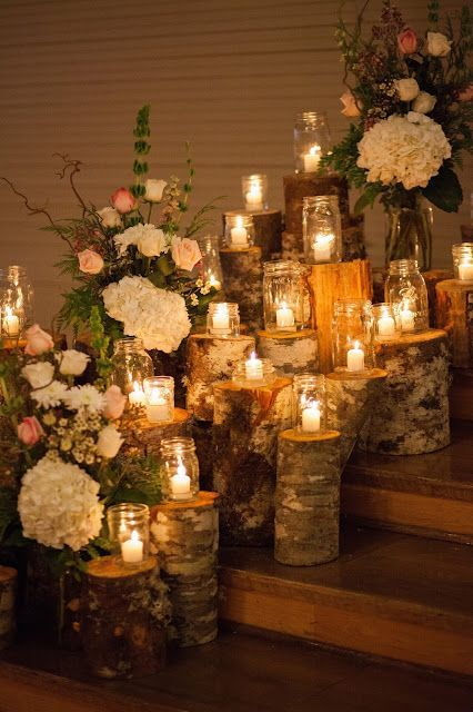 Mason Jars and logs make for a dreamy back drop and would be a perfect look for an evening wedding. Mason jars can be purchased in cases or found at garage sales and thrift stores for reasonable prices.