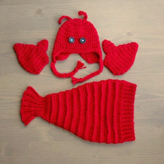 Your baby will look adorable in this crocheted lobster costume, pictured above in newborn size! This set is made with bright red acrylic yarn, accented with black plastic button eyes. This costume is both adorable and comfortable for your baby to wear. It would make a perfect gift for baby showers, or an adorable choice for your babys first Halloween. It could also make a great prop for your babys first photo shoot. This set is made with 100% acrylic yarn, which is easy to clean, and will…