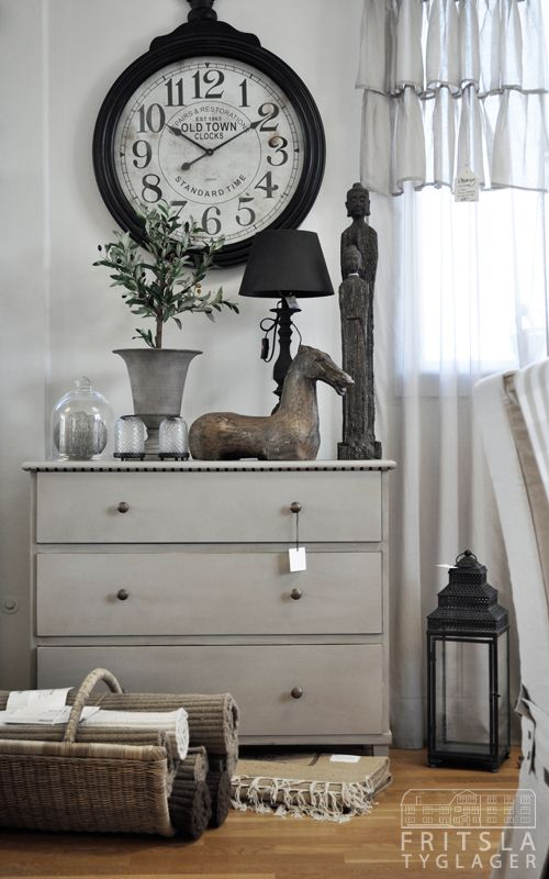 Love the clock, and all the rest, too--pretty finish on the dresser.