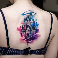 Watercolor Disney castle tattoo on back by Uncl Paul Knows