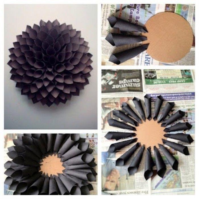 Dahlia van papier - Rolletjes maken van memoblaadjes of klein vouwpapier (ca. 10x10 cm) en stapelen tot een mooie bloem. Eenvoudig, maar wat een mooi resultaat!