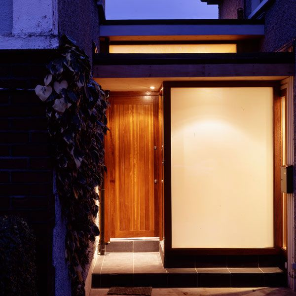 The appearance from the road is one of solidity with Opal glass and the timber sheeted door providing privacy