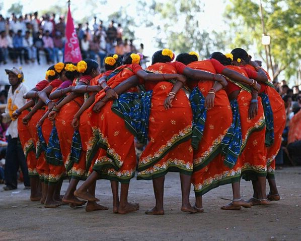 tribal dancers at local festival, orissa, india