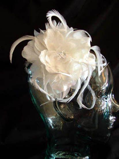Organza petals, ostrich feathers, rhinestones. $85 CAD (2013)