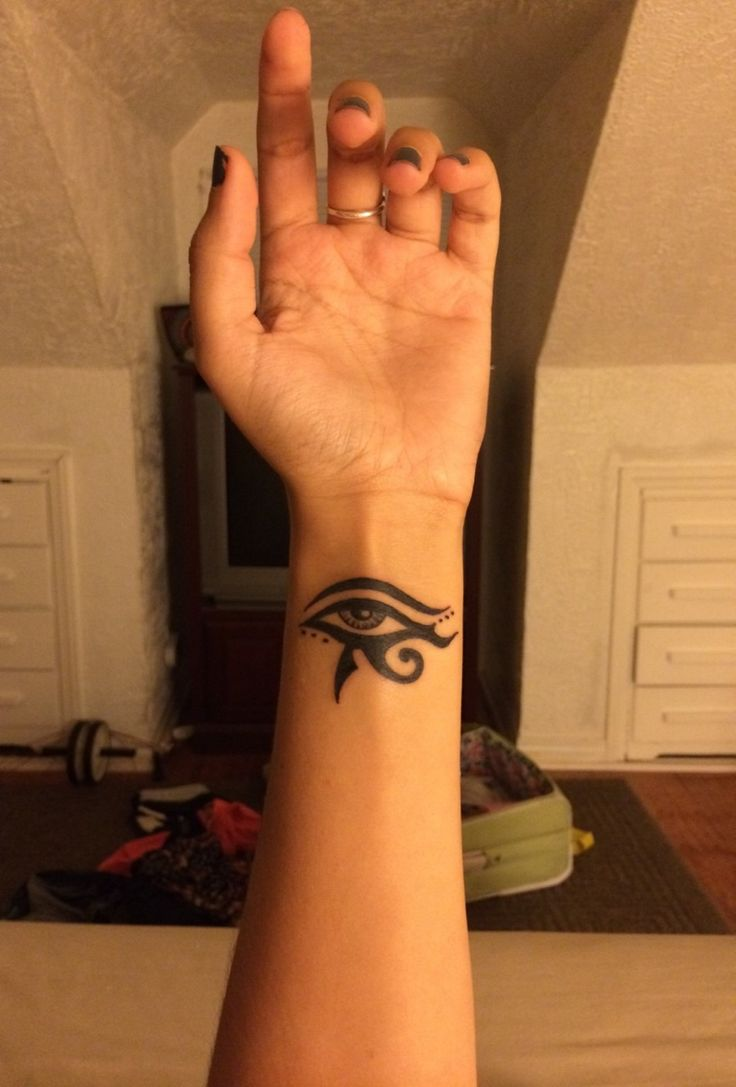 eye of horus tribal wrist tattoo