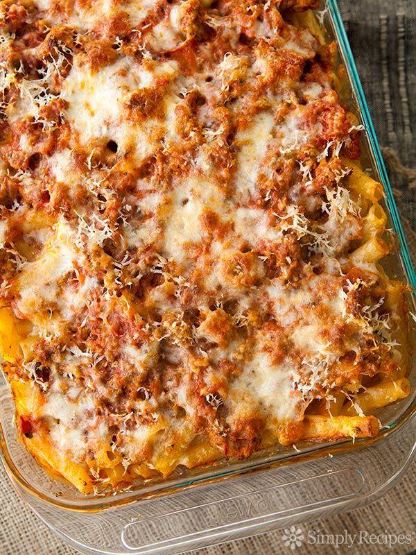 Baked Ziti! Classic Italian American comfort food. Pasta baked with sausage, tomato sauce and all kinds of gooey, yummy cheeses. So EASY and so good, perfect for a family meal!! On SimplyRecipes.com
