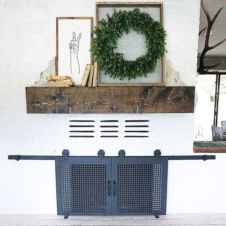 Custom built sliding barn door style fireplace screen