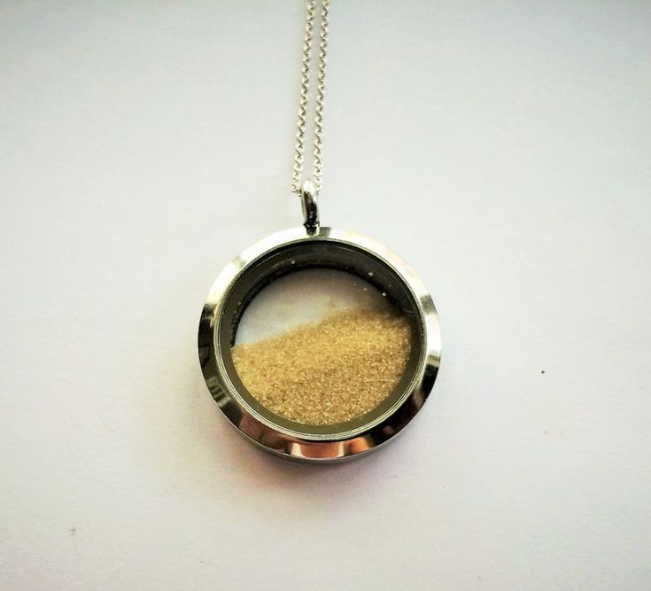 Beach Sand Locket / Destination Wedding Necklace / Beach Wedding / Memory locket / Keepsake / Momento / Gift boxedThis quality made rhodium plated waterproof locket features a screw off glass framed top that accesses a recessed area that can be fi...
