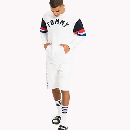 Tommy Hilfiger men's sweatshirt. Made from the soft-washed fleece that's made us famous for years, the athletic classic gets an update with colorblock armbands for a sporty finish. From the Tommy Jeans collection.