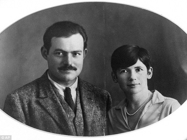 Ernest Hemingway and Pauline Pfeiffer pose in their wedding day photo from May 10, 1927 in...