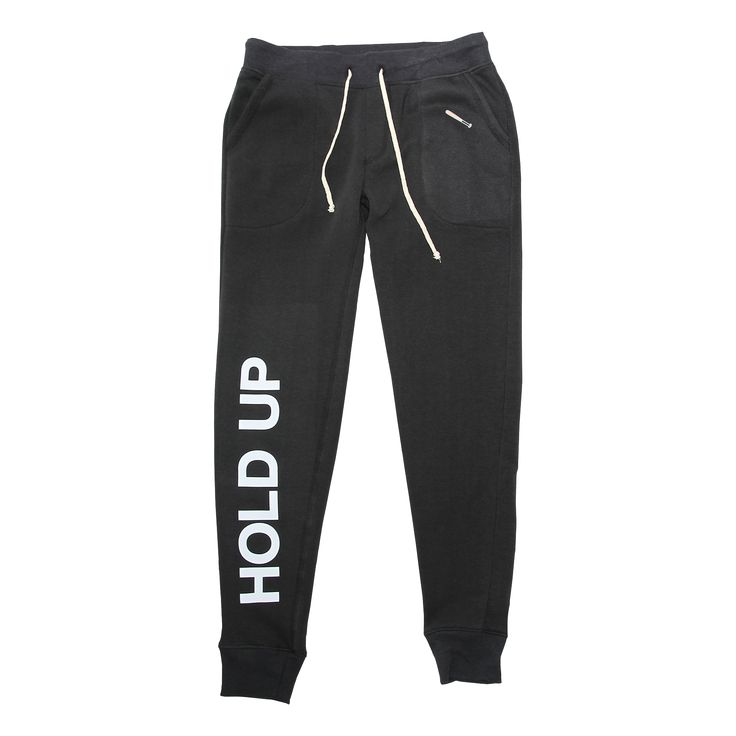 Women's slim fit jogger featuring multi-graphic embellishments.