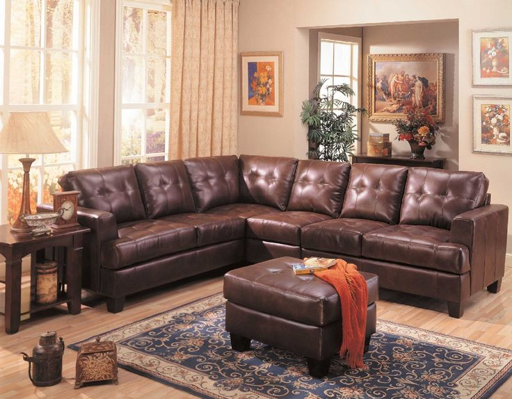 This Stunning Sectional Sofa Features Clean Lines And Attached Cushions.  Offering 100% Bonded Leather