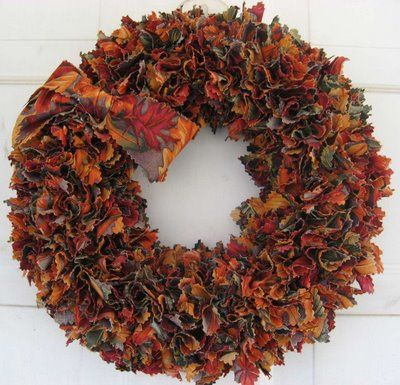 "One of my favorite autumn wreaths! Cut 3"" square fabric shapes, take a ballpoint pen or phillips head screwdriver and push the pieces of fabric into a straw wreath form."