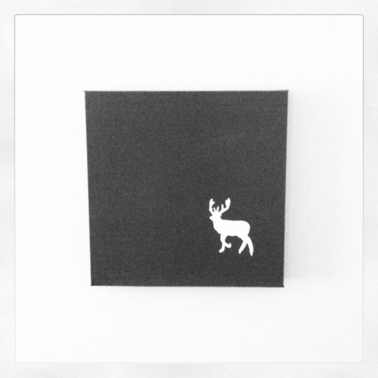 White stag stencil on brown canvas