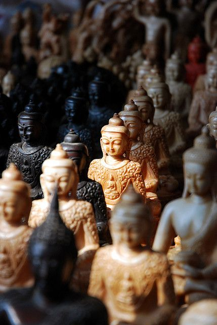 Buddhas for Sale in Nepal. Photographer's Note: The Buddha has become a commodity in his birthplace of Lumbini, Nepal. There, pilgrims from around the world converge to see the place he was born and buy a few religious trinkets, including these Buddha statues, along the way.