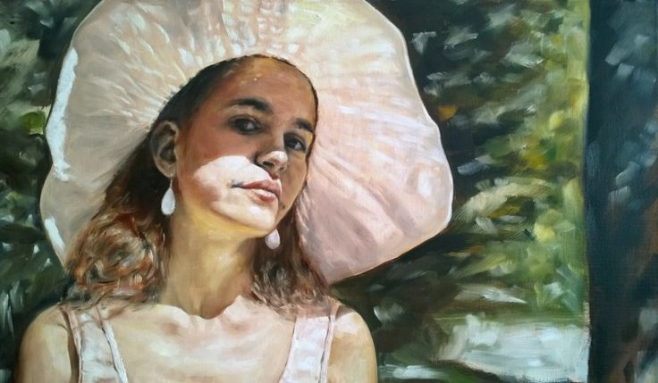 Large portrait of a woman in the park, with great portion of bright summer sunlight for any interior.