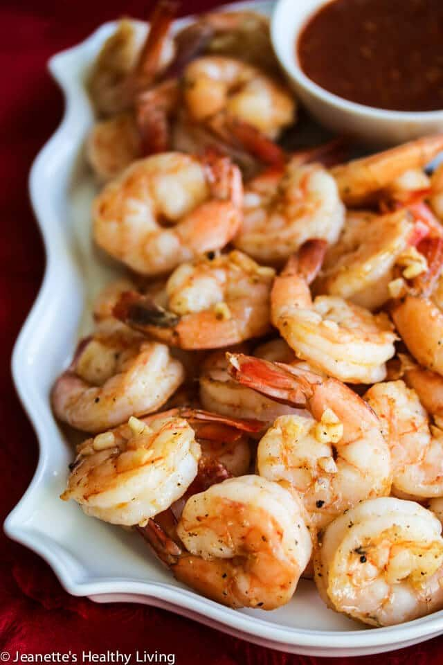 Roasted Shrimp Cocktail- Roasting the Shrimp + Fresh Garlic + Spanish Smoked Paprika take this Shrimp Cocktail to a whole new level - I just made these for a big gathering and they were a huge hit! http://jeanetteshealthyliving.com