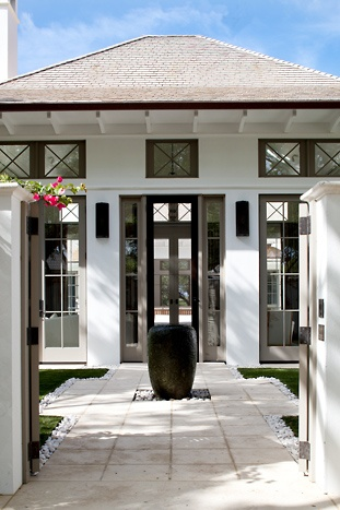 Lovely arts & crafts influence with view through the house from the front to back.  Also beautiful exterior color scheme white + brown