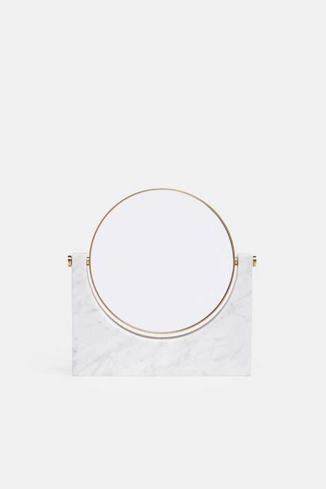 """In creating this tabletop mirror for Menu, Milan-based Studiopepe looked to Italian design of the late 1950s, especially the work of Gio Ponti, Luigi Caccia Dominioni, and Carlo de Carli, who elevated quotidian objects with sleek forms and precious materials. The disc of mirrored glass—one side magnifies (3x) and the other does not—is framed in brass and set in a streamlined stand of white marble. """"We like to use really great materials, which gain beauty over the years—not the opposite,""""…"""