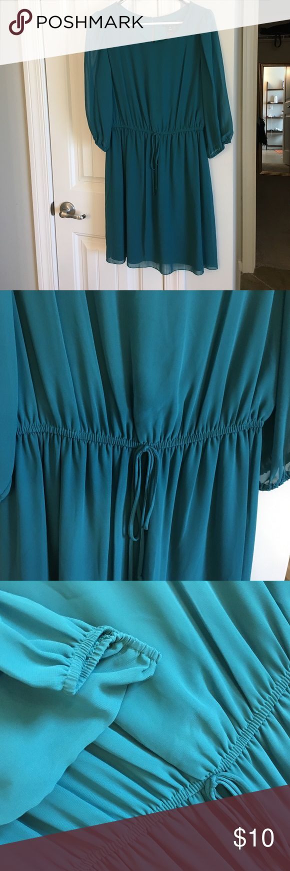 Teal Long sleeve draw string waist dress Teal, long sleeve knee length dress. Light float material with teal lining. Elastic around arm holes. Beautiful color. Size 10. Great Condition. Never worn. Dresses