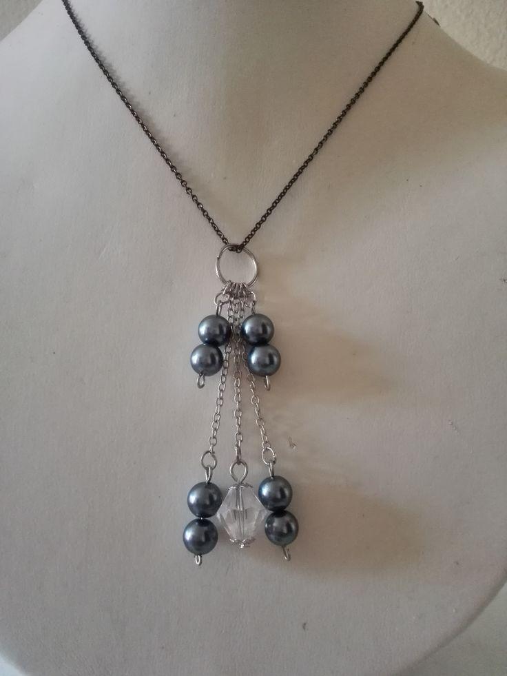 Dark imitation pearls on a black twine.