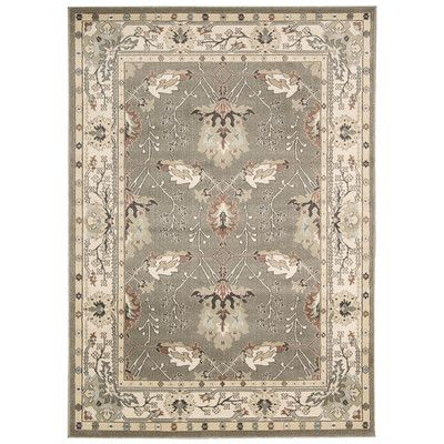 Features: -100% Polypropylene. -Gray and Ivory. -Power-loomed. -The secondary colors for the rug are gray, ivory, orange, white and beige. Primary Color: -Gray/Ivory. Border: -Yes. Border Color