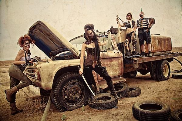 Mad Max-inspired cosplay perfectly captured by photographer Crysco Photography. It features Scarlett Reign as V, Paul Heinrich Speicher as GearJammer, Kelsey Scott as Firestone, and Aileth Bran as Oona as part of an original concept called Badlands.