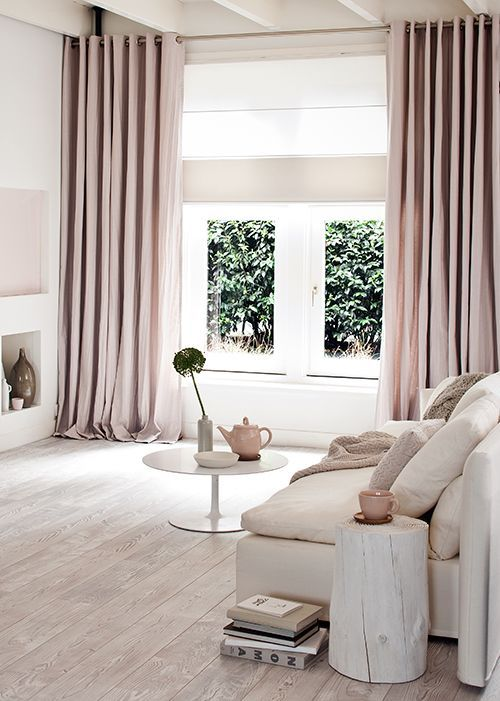 Pale colour scheme + floor to ceiling curtains.
