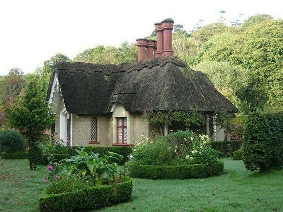 Thatched roof & tall chimneys...