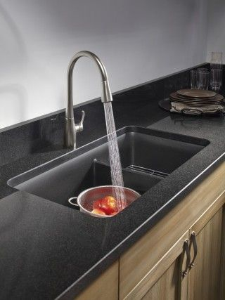 Simplice faucet   Cairn sink   The straightforward shapes of the sink and faucet add crisp style to a minimalist kitchen.