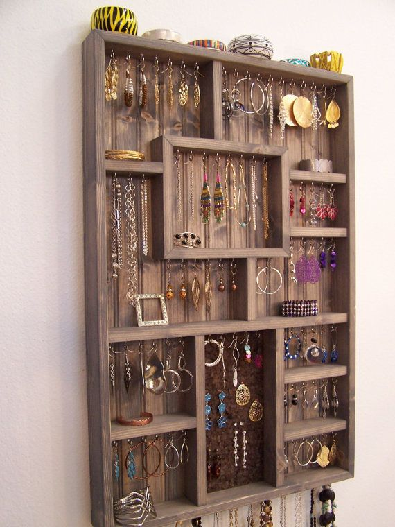 This large wall jewelry display case can be used to organize your necklaces, bracelets, watches, rings, and earrings. Comes ready to hang and